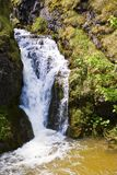 Waterfall. Water falling down the high stone cliff stock photos