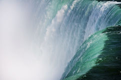 Waterfall. Detailed look of Niagara Falls as the powerful waterfall plunges over into the gorge stock photography