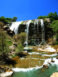 Waterfall. Beautiful multi-layered waterfall between vegetation stock images
