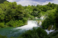 Waterfall. View of the waterfall surrounded by trees from the top of Stock Image