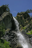 Waterfall. S on the background of blue sky (Russia, Caucasus royalty free stock photo