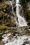 Long exposure waterfall in spring over big rocks Royalty Free Stock Photography