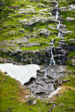 Waterfall. Mountain waterfall with snow. Norway Stock Image
