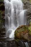 Waterfall. A rocky waterfall photographed with a slow shutter speed creating soft flowing water Royalty Free Stock Images