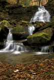 Waterfall. Moss covered waterfall in the forest Stock Photo