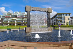 Waterfall. Nice water fountain that stands in the middle of the park in Kristiansand (Norway). The fountain is built of steel and granite and will provide the Royalty Free Stock Photography