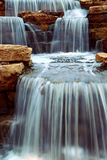 Waterfall. Beautiful cascading waterfall over natural rocks, landscaping element
