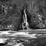 Waterfall. From small stream plunges into river, black and white royalty free stock images