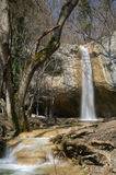 Waterfall. A waterfall and a river in a mountain forest Stock Photos