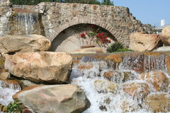 Waterfall. Decorative waterfall with large rocks and vines Stock Image