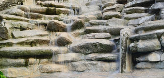 Waterfall. Stone wall and the flowing water Royalty Free Stock Photos