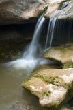 Waterfall. River waterfall with wateer flowing between rocks Royalty Free Stock Photos