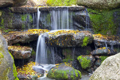 Waterfall. In the forest. beautiful background of stone, water, moss Royalty Free Stock Images