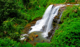 The waterfall. With the mountains in the country of Sri Lanka Royalty Free Stock Image