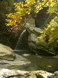 Waterfall. Rock pool with waterfall in autumn stock images
