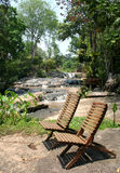 Waterfall 3. Two chairs near the waterfall royalty free stock photography