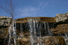 Waterfall 3. The top of a man made waterfall against a bright blue sky Stock Photography