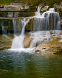 Waterfall. A small multi-tiered waterfall stock images