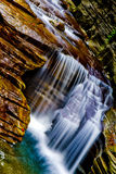 Waterfall. A small multi-tiered waterfall stock image