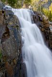 Waterfall. High in the mountains Stock Image