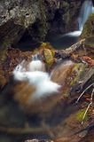Waterfall. Highway green moss and flowing water Stock Photography