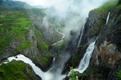 Waterfall. Voringsfossen waterfall in Norway with lush greenery and mountains
