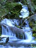 Waterfall. Beautiful multi-layered waterfall between vegetation Royalty Free Stock Image