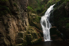 Waterfall. Small waterfall in the mountains Stock Photos