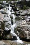 Waterfall. Water rushing down the piles of rocks forming a beautiful waterfall Stock Photos