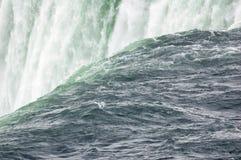 Waterfall. Blue-green water, falling down from Niagara falls Royalty Free Stock Image