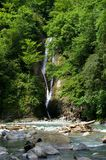 Waterfall. And river in Georgia mountains in summertime (the Caucasus Stock Image