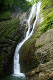 Waterfall. And river in Georgia mountains in summertime (the Caucasus Royalty Free Stock Photography