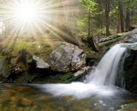 Waterfall. In the woods with the sun in Sumava-Czech republic Stock Photos