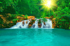 Waterfall. In tropical forest at sunny day
