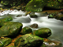 Waterfall. Is a place that will make you relax and fresh Royalty Free Stock Images