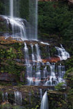 Waterfall. Misty Katoomba waterfalls in Blue mountains National park in NSW, Australia. Vertical composition royalty free stock photos