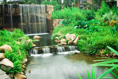 Waterfall. Beautiful waterfall in a green garden Stock Images