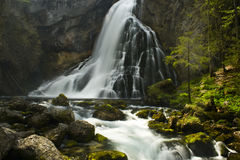 Waterfall. Big waterfall with rapids in the alps Stock Photos