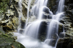 Waterfall. Beautiful Waterfalls rushing down the slippery rocks royalty free stock images