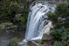 Waterfall From Above. Wide waterfall after heavy rain, view of falls and landscape Stock Photo