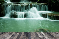 Waterfall above a wooden floor Royalty Free Stock Image