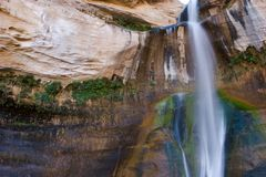 Waterfall against red rock Royalty Free Stock Photo
