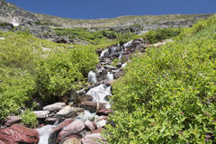 Waterfall along Grinnell Glacier Trail - Glacier National Park Royalty Free Stock Photography