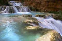 Waterfall along Havasu Creek. Turquoise water of Havasu Creek along the Grand Canyon of Arizona Royalty Free Stock Photos