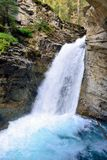 Waterfall along the Icefields Parkway in the Canadian Rockies between Banff and Jasper Royalty Free Stock Photography