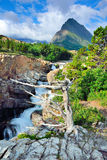 Waterfall and alpine scenery of the Glacier National Park Royalty Free Stock Photo