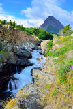 Waterfall and alpine scenery of the Glacier National Park Royalty Free Stock Photos