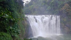 Waterfall amidst lush vegetation. Shifen waterfall amidst lush forest vegetation at Keelung County, Taiwan royalty free stock images