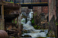 Waterfall through ancient industry buildings. Mölndals Kvarnby. Waterfall through the ancient industry buildings of Mölndals Kvarnby, near Gothenburg in Sweden stock photo