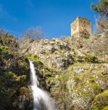 Waterfall & ancient stone tower at Castifao in Corsica Stock Images